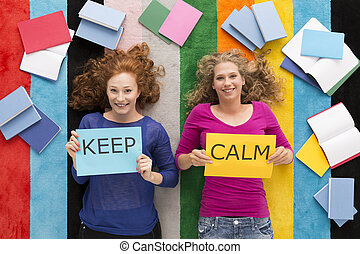 Keep calm and study - Top view of a two happy students...