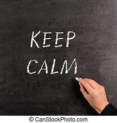 Keep calm - Hand writing with chalk KEEP CALM on a...