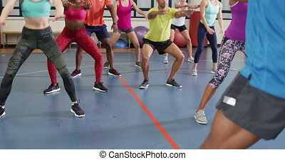 Keep fit class at a gym - Over the shoulder view of an ...