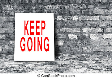 Keep going sign - Keep Going sign on floor in black interior