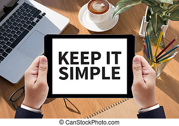 KEEP IT SIMPLE Businessman work  on tablet on screen