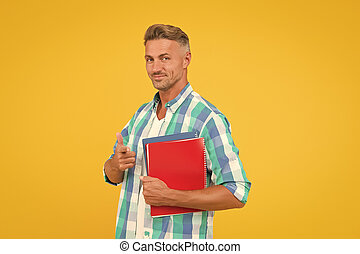 Keep learning all life. College university education. Man adult student. Final exam and graduation. Dedicated to studying. Student with textbooks. Regular student carry workbooks. Student life