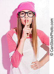 Keep my secret! Playful young woman in pink headwear and ...