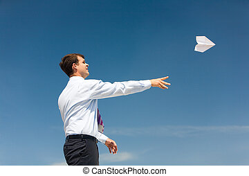 Keep on flying - Conceptual photo of businessman standing...