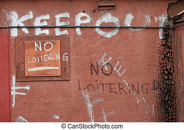 keep out and no loitering, strong message painted on a back ...