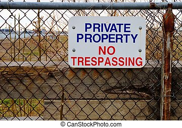 Keep Out! - Chain link fence with colorful No Trespassing ...