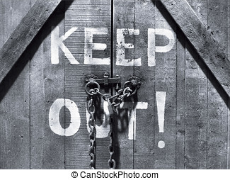 Keep out! - Closeup of Keep Out sign on wooden door