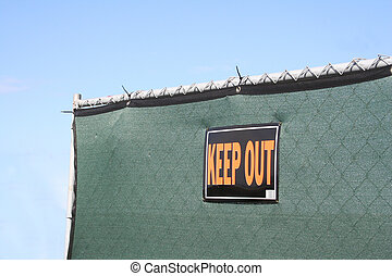 Keep Out Fenace - A green privacy fence with a KEEP OUT sign...