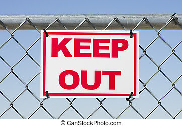Keep Out - red and white keep out sign on a chain link fence