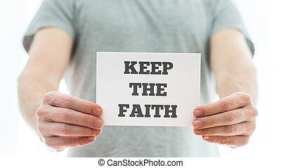 Keep the faith message - Closeup of a homeless man holding ...