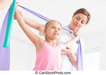 Keep this posture! - Shot of a little girl doing exercises...