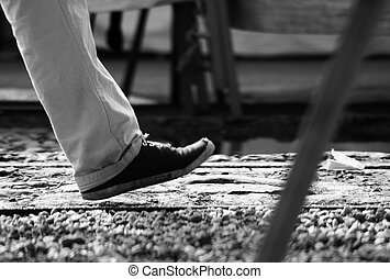 keep up - The photograph of a body part, legs, passing a ...
