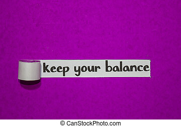 Keep your balance, Inspiration, Motivation and business concept on purple torn paper