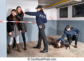 Keeping bystanders at a distance - Policeman setting the...