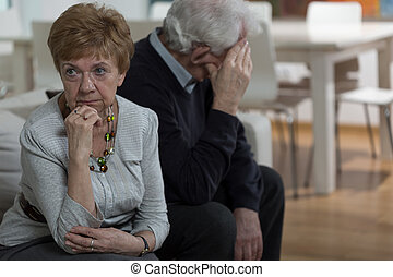 Keeping quiet - Two aged married people keep quiet after...