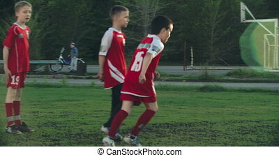 Keeping the Ball - Teen football players busy in a game,...