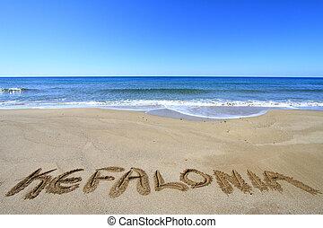 Kefalonia written on sandy beach
