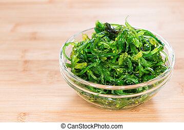 Kelp Salad (detailed close-up shot) on wooden background