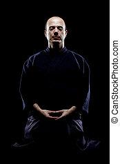 Kendo fighter - portrait of a kendo fighter meditating,...