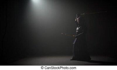 Kendo instructor practicing martial art with the Katana Katana shinai.