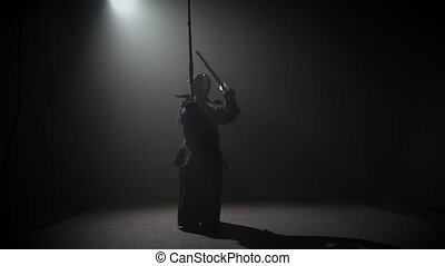 Kendo instructor practicing martial art with the Katana...