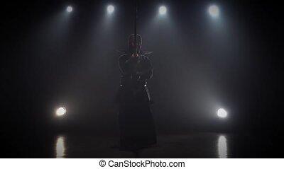 Kendo master practicing martial art with Katana shinai, slow...