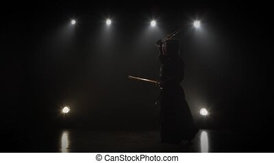 Kendo master practicing martial art with the shinai sword. -...