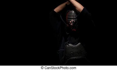 Kendo warrior coming out of darkness into the light. Slow...