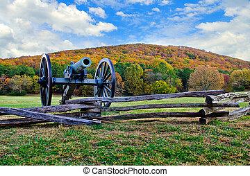 Civil War era cannon overlooks Kennesaw Mountain National Battlefield Park during fall or autumn