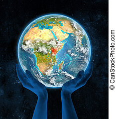 Kenya on planet Earth in hands