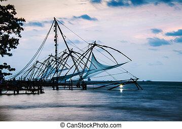 Kerala, India. Chinese fishnets at sunset