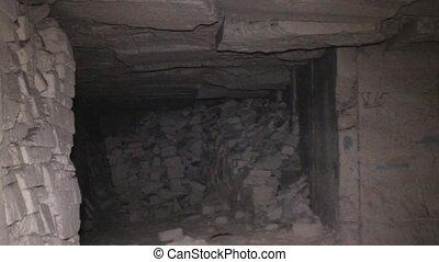 Kerch catacombs and wandering spelunker (explorer of...