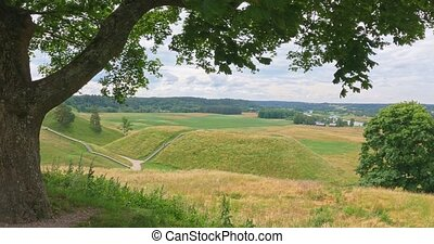 Kernave - medieval capital of Lithuania. Historic mounds are popular tourist attraction.