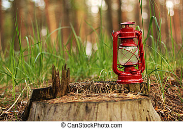 Kerosene lamp in the forest. Abstract photo