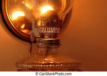 Kerosene lamp - lit golden kerosene lamp details closeup ...