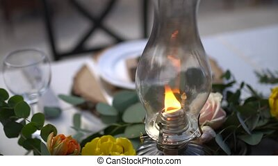 kerosene lamp on the table at the wedding banquet. High quality FullHD footage