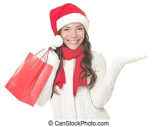 kerst boodschapend doend, vrouw, het tonen, copyspace, opgewekte