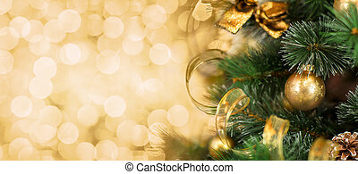 kerstboom, tak, met, vaag, gouden achtergrond
