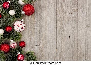 kerstmis, bovenkant, grens, van, rood en wit, baubles, met, takken, op, grijs, hout