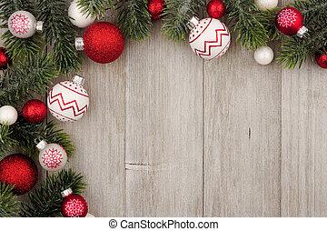 kerstmis, hoek, grens, van, rood en wit, baubles, met, takken, op, grijs, hout