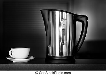 Kettle and cup - Stainless steel kettle and white coffee cup