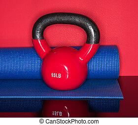 Kettle Ball Workout - Red Kettle ball on red background with...