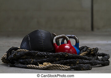 Kettle bells, rope and a medicine ball used for crossfit