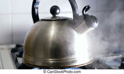 Kettle boiling hot stove