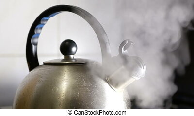 Kettle boiling hot stove - Kettle boiling on a gas stove hot