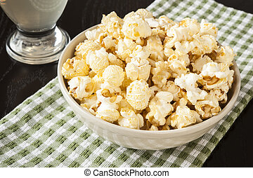 Kettle Corn Snack - Dish of kettle corn and a glass of juice