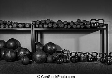 Kettlebells dumbbells and weighted slam balls weight training equipment at gym