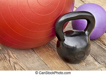 kettlebell and exercise balls - black iron kettlebell, Swiss...