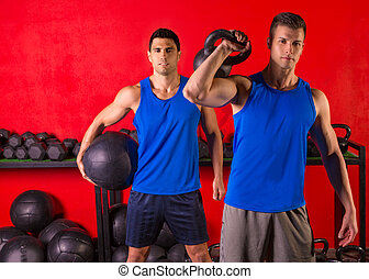 Kettlebell and weighted ball workout gym men