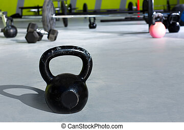 Kettlebell at Cross fit gym with lifting bars in background